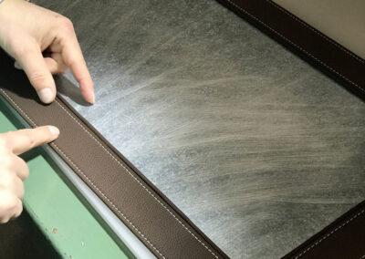 lavorazione alluminio e pelle e Galuchat per complementi di arredo