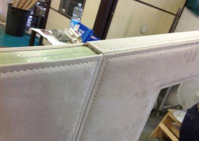 pannelli rivestiti con soft touch nabuk e impuntura perimetrale a vista